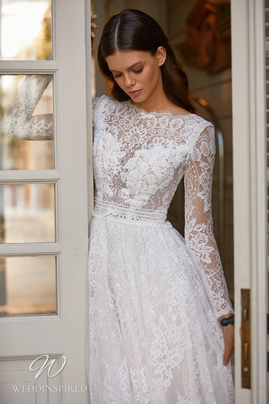 A Milla Nova 2021 lace A-line wedding dress with long sleeves and a high neckline