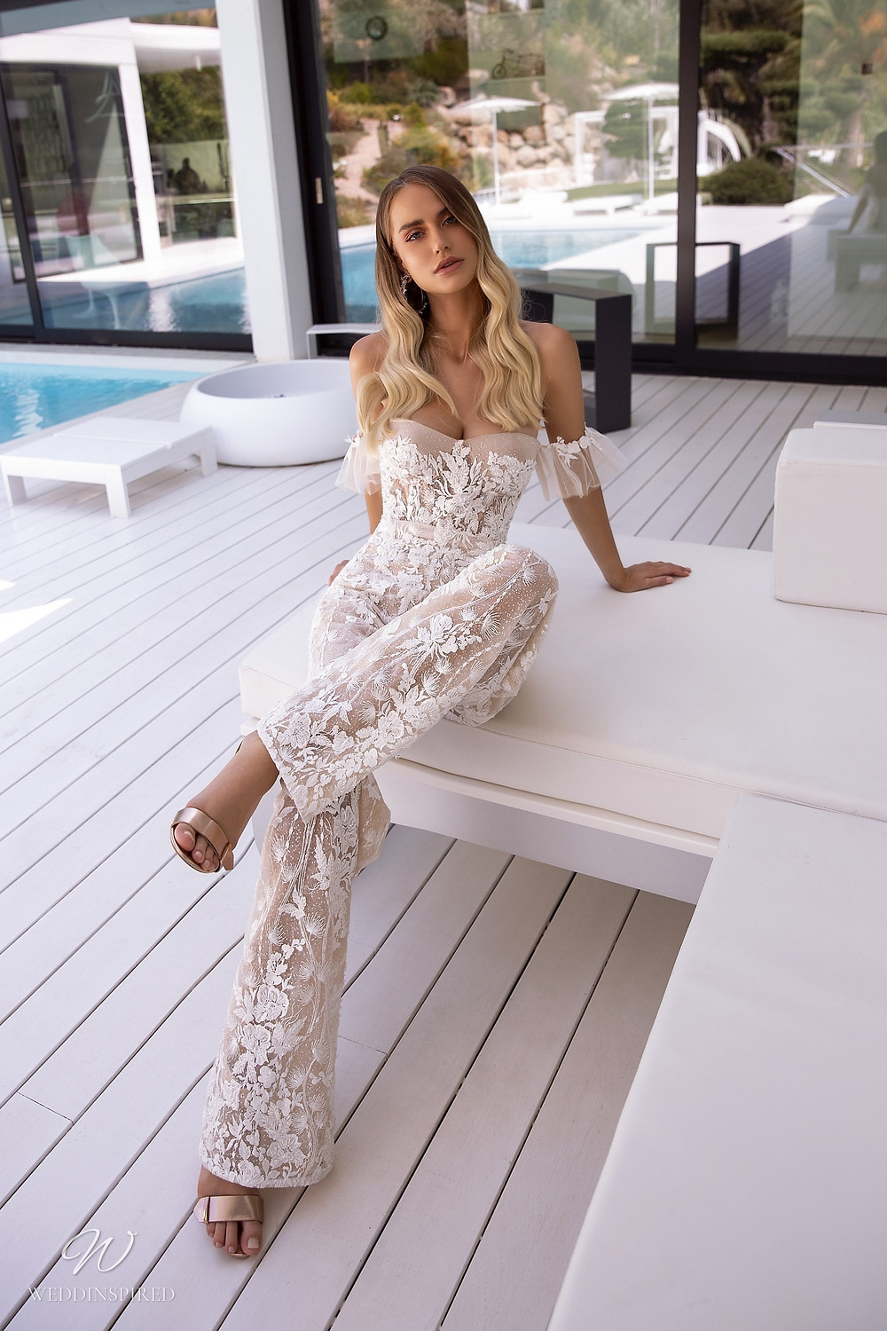 A Tina Valerdi strapless lace wedding jumpsuit or pantsuit with a sweetheart neckline