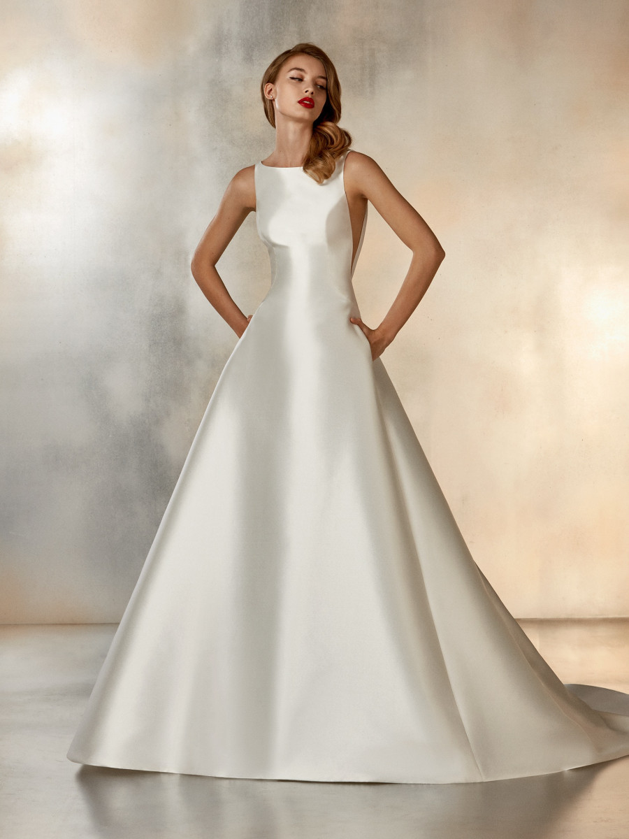 A Pronovias simple silk ball gown wedding dress with pockets