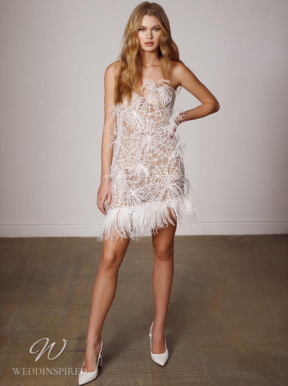 A Galia Lahav 2022 strapless nude short wedding dress with feathers and fringe
