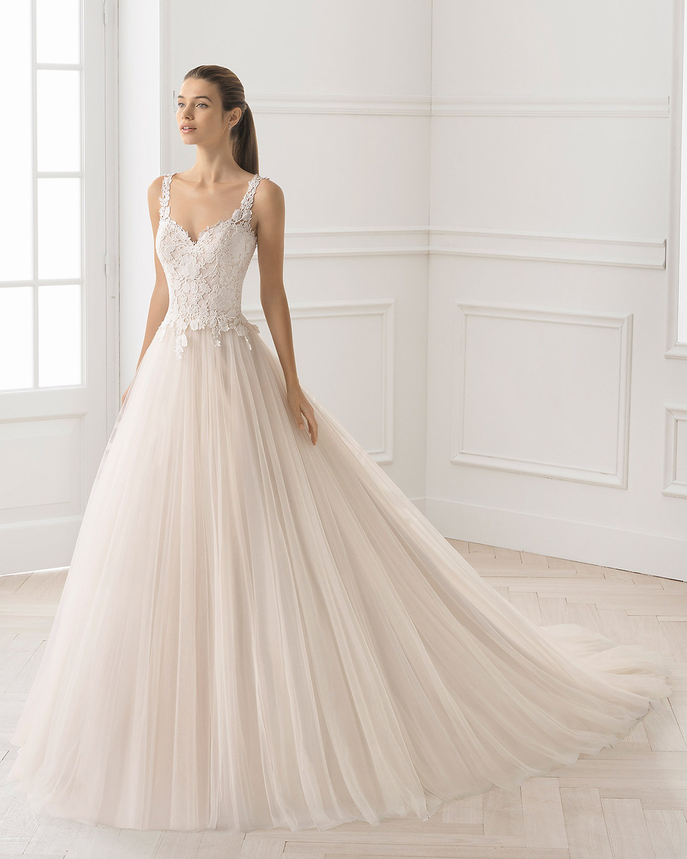 An Aire Barcelona 2020 ivory lace and tulle ball gown wedding dress with straps