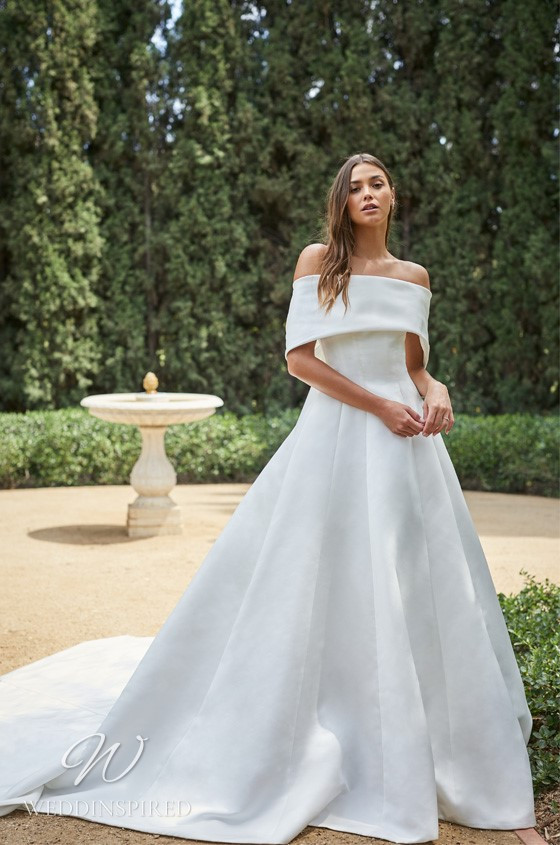 A Monique Lhuillier off the shoulder silk ball gown wedding dress