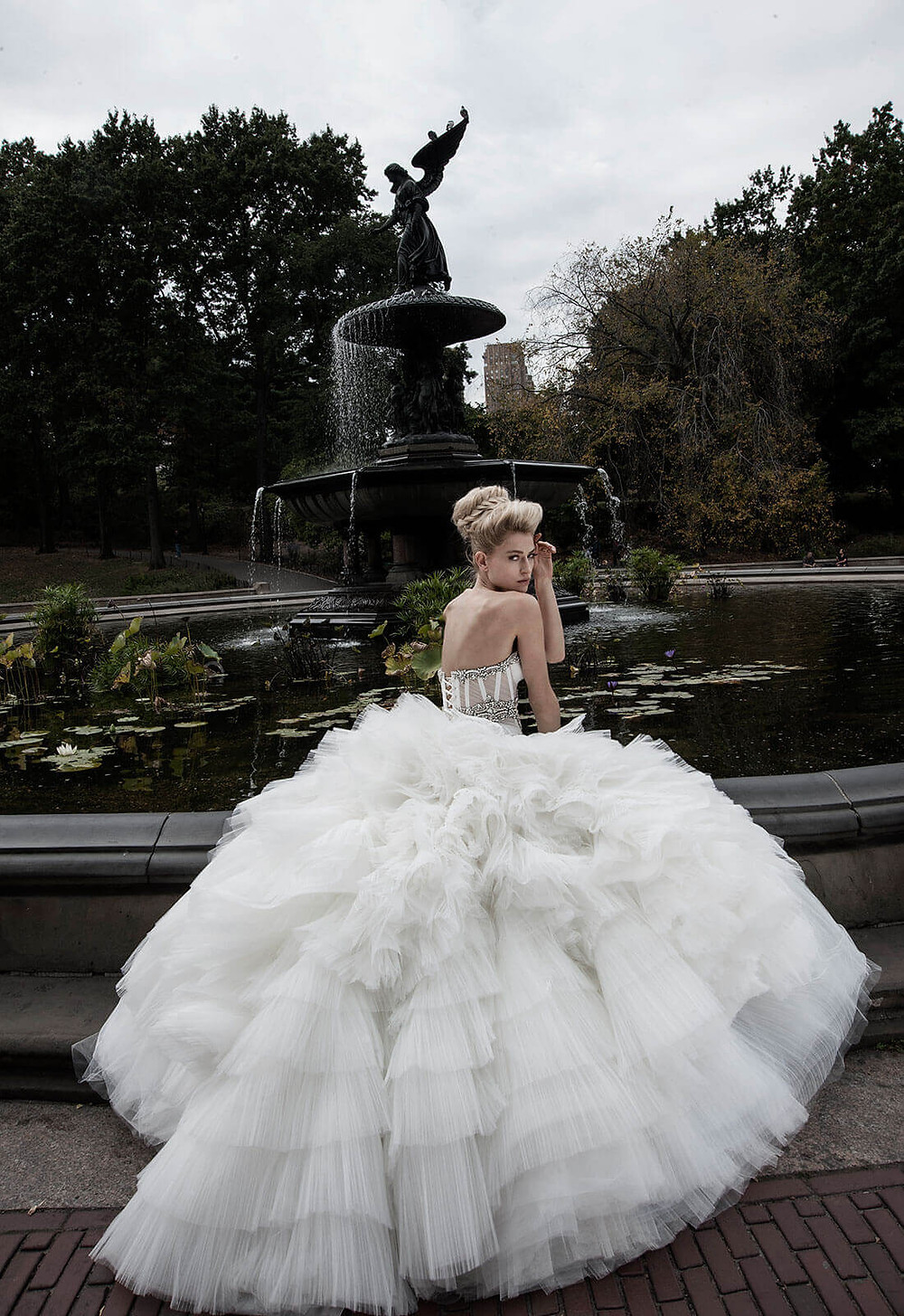 A Pnina Tornai strapless ball gown wedding dress with a layered tulle skirt and a corset with crystals