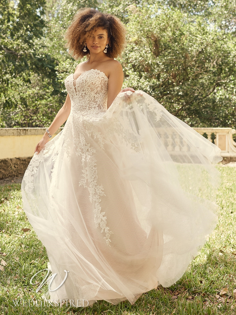 A Maggie Sottero 2021 strapless lace and tulle A-line wedding dress