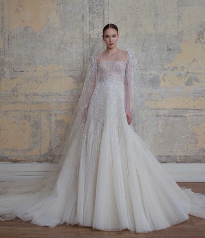 A Georges Hobeika 3/4 sleeve, ball gown wedding dress, with tulle skirt and crystals
