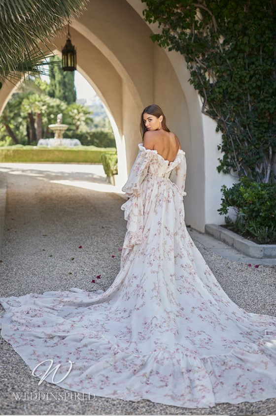 A Monique Lhuillier off the shoulder boho style floral A-line wedding dress with ruffles