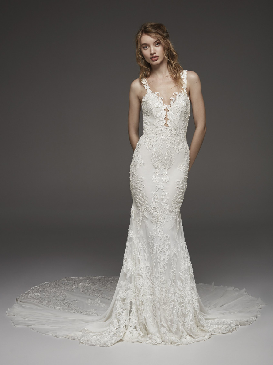 A Pronovias romantic lace mermaid fit and flare wedding dress with straps and a train