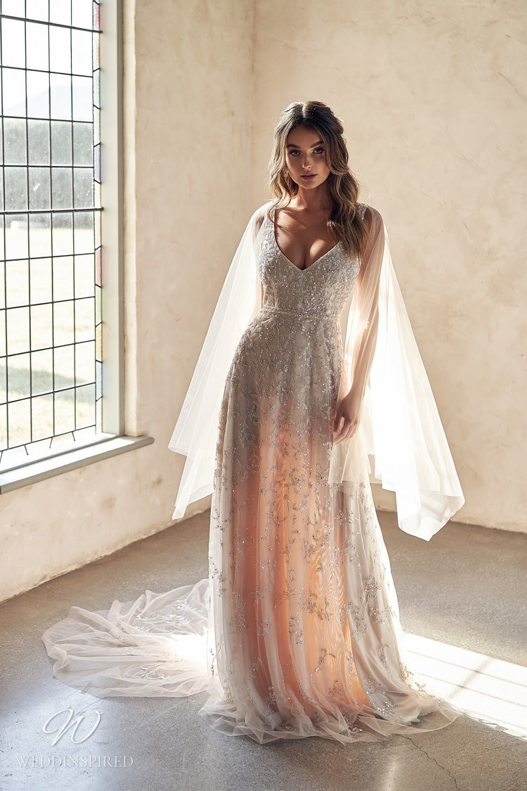 An Anna Campbell 2020 blush v neck A-line weeding dress with beading and a veil