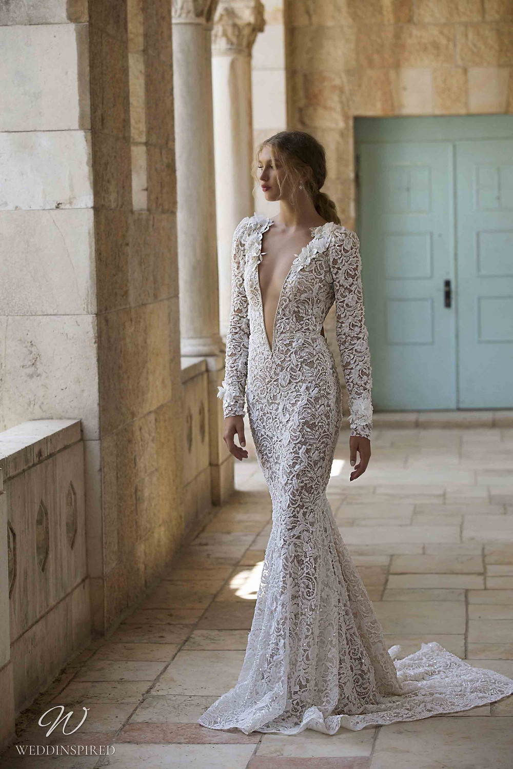 A Berta Colony 2021 lace mermaid wedding dress with long sleeves and a low v neckline
