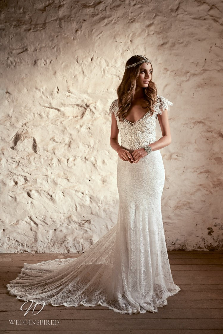 An Anna Campbell 2020 lace mermaid wedding dress, with cap sleeves and a v neck