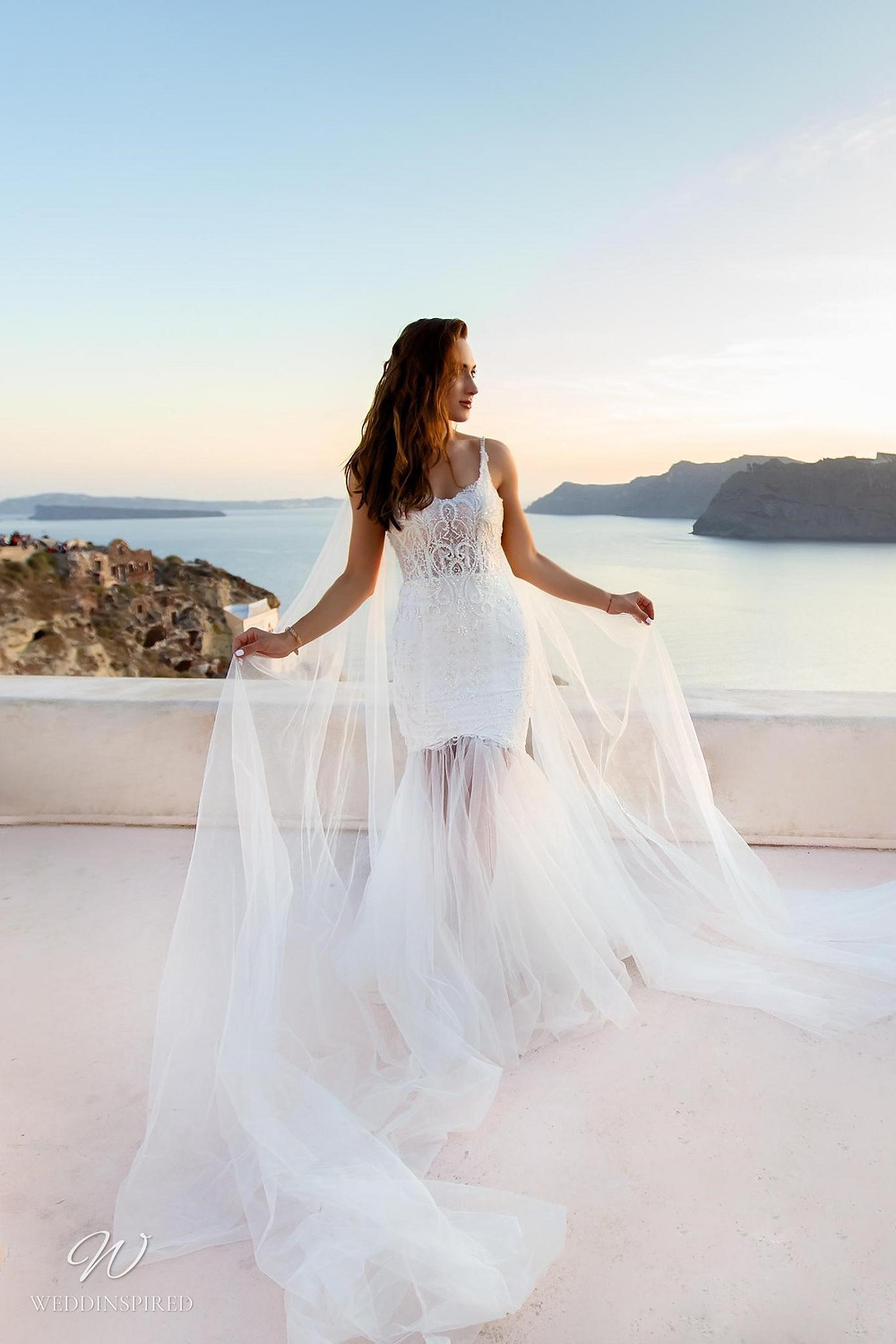 A Ricca Sposa lace mermaid wedding dress with a tulle skirt and straps