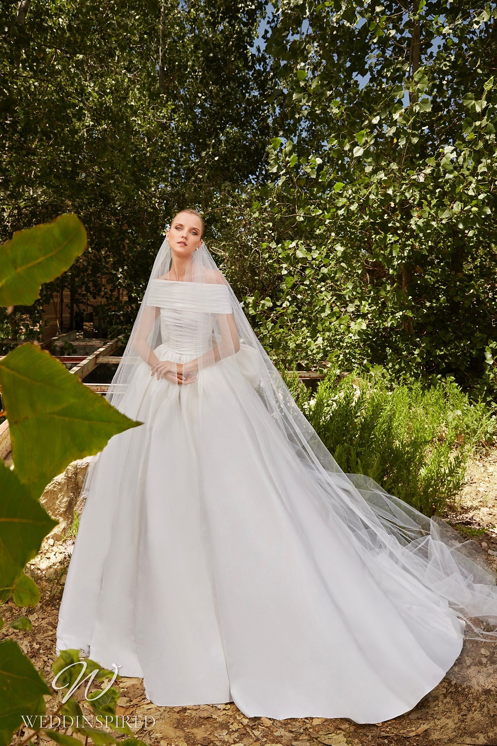 An Elie Saab Spring 2021 simple off the shoulder satin ball gown wedding dress