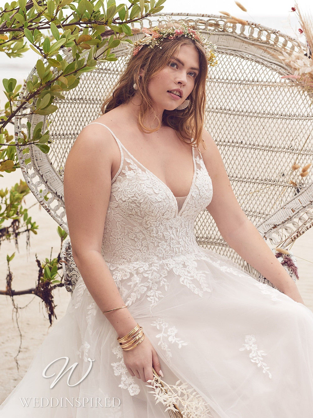 A Rebecca Ingram 2021plus size lace and tulle A-line wedding dress