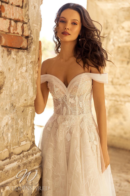 An Eva Lendel 2021 lace off the shoulder A-line wedding dress