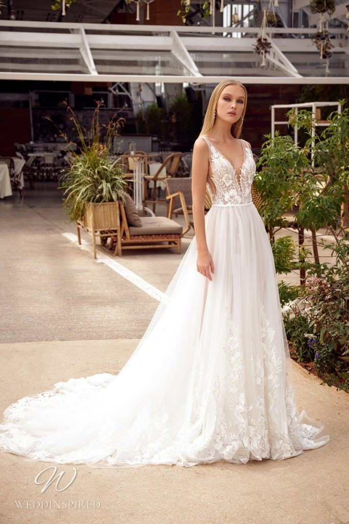 A Julie Vino 2021 ivory lace and tulle A-line wedding dress with a v neck