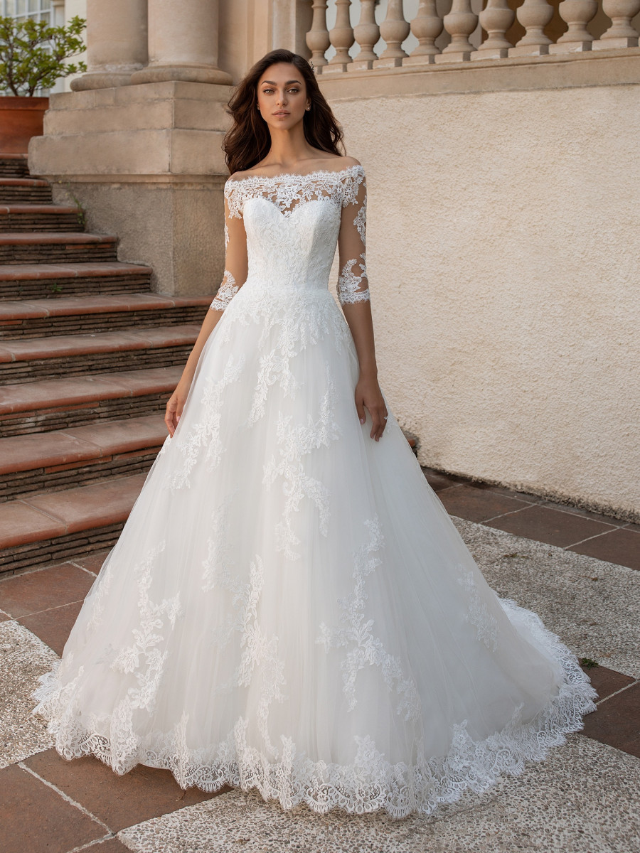 A Pronovias 3/4 sleeve, ball gown wedding dress, with lace and illusion sleeves