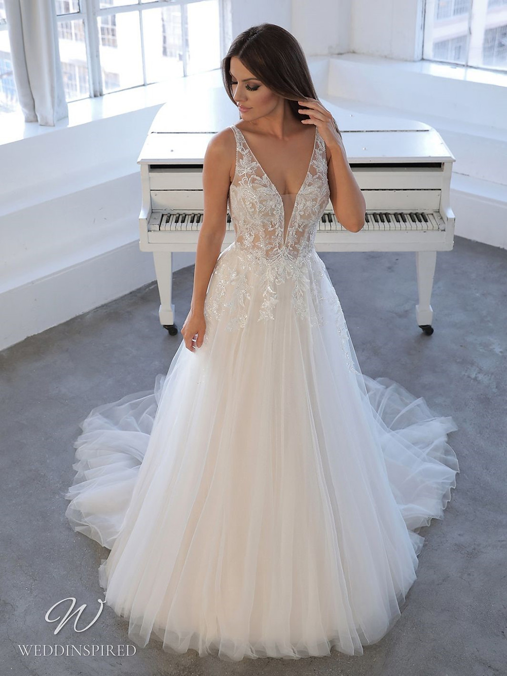 A Blue by Enzoani 2021 lace and tulle A-line wedding dress with a v neck
