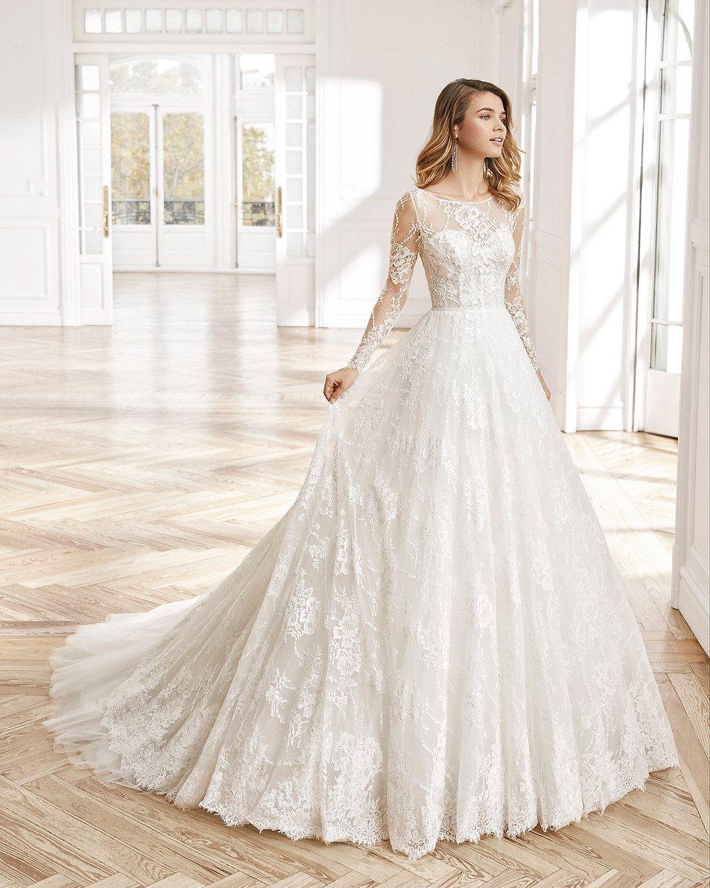 An Aire Barcelona 2020 lace princess ball gown wedding dress with long illusion sleeves