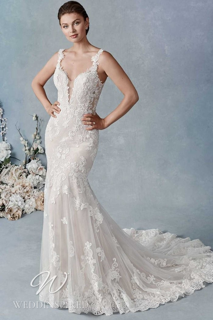 A Kenneth Winston 2021 lace mermaid wedding dress with straps and a v neck