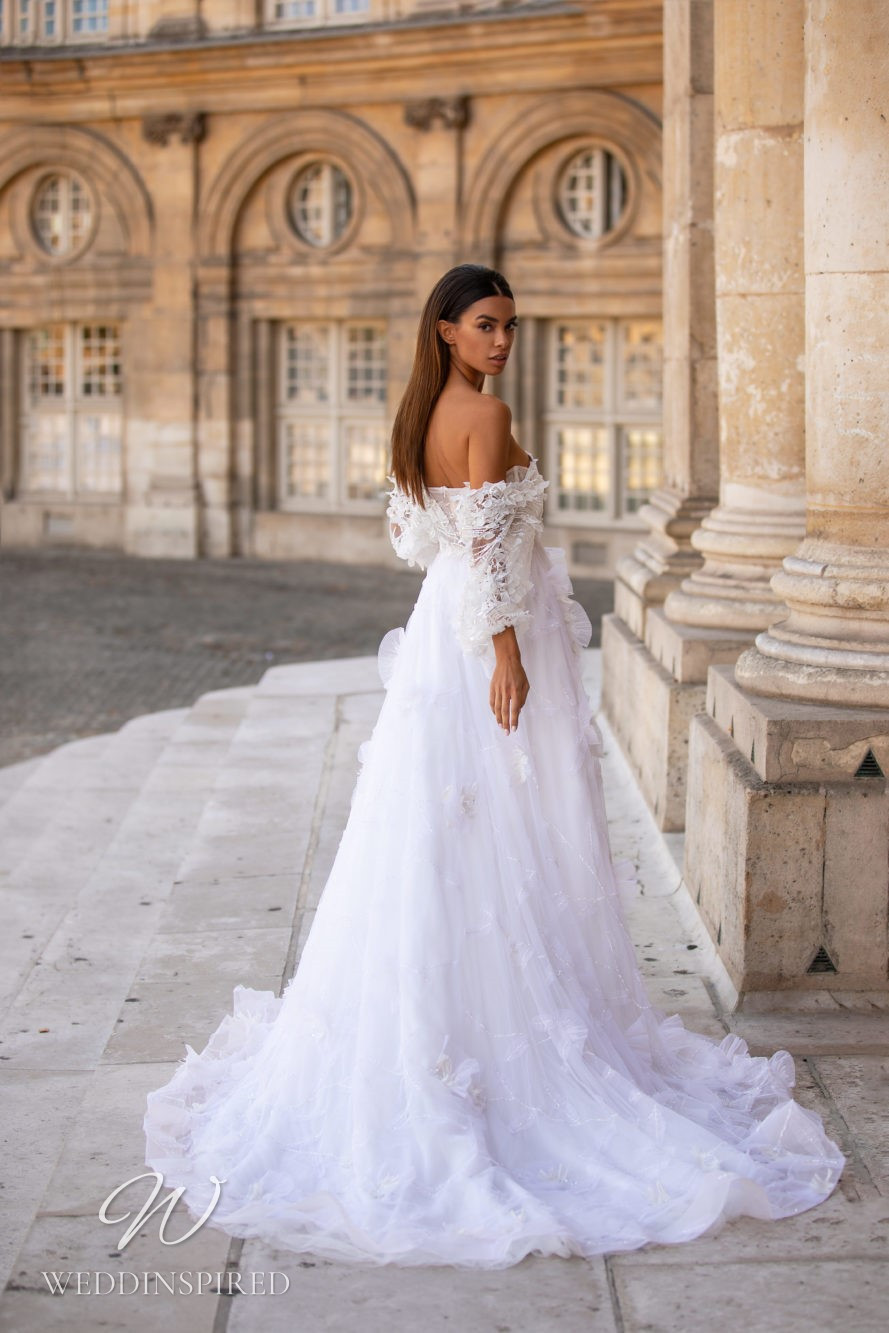 A Milla Nova tulle and lace off the shoulder ball gown wedding dress