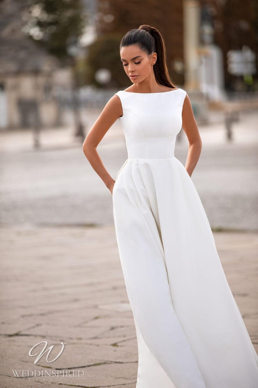 A Milla Nova modest high neck A-line wedding dress