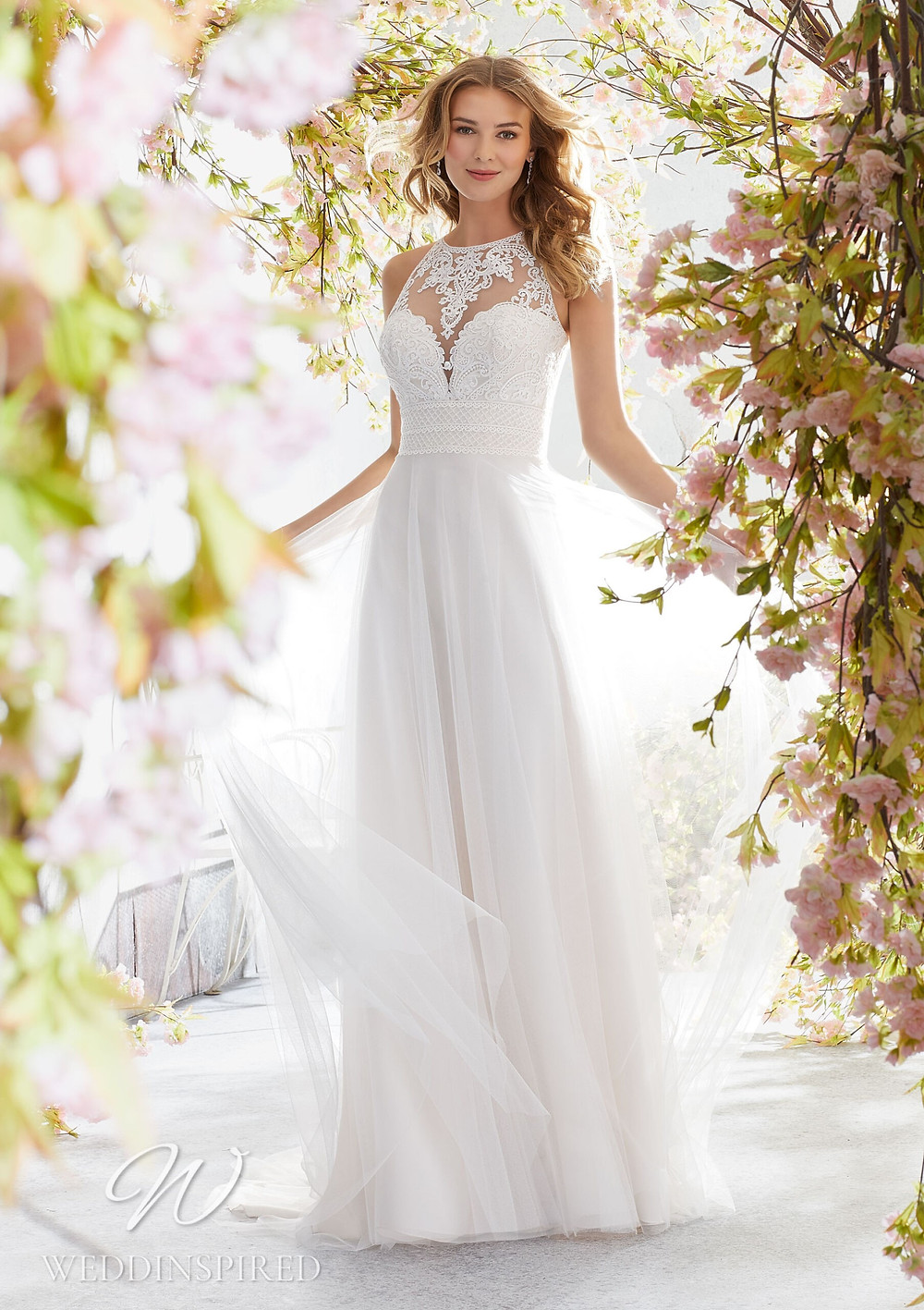 A Madeline Gardner lace and tulle A-line wedding dress