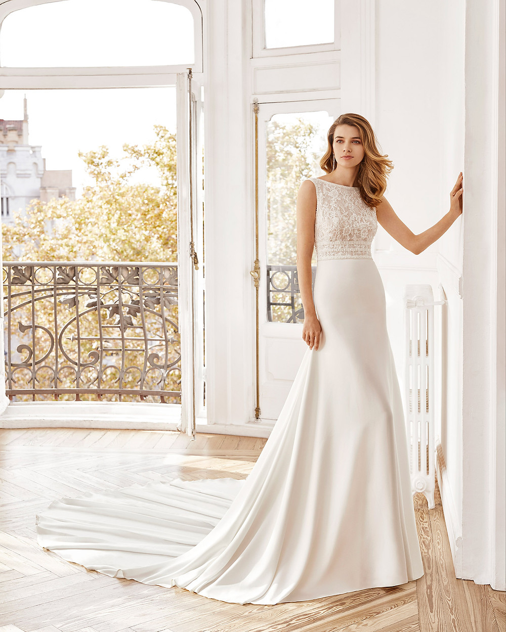 An Aire Barcelona 2020 lace and crepe A-line wedding dress with a high neckline
