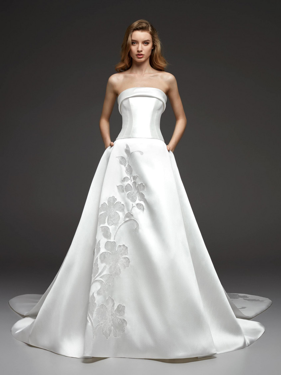 A Pronovias strapless silk ball gown wedding dress with pockets and flowers