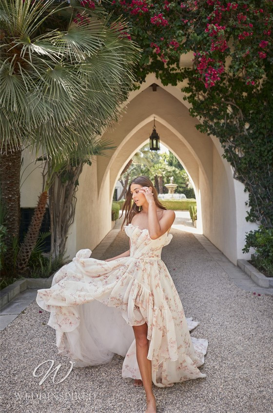 A Monique Lhuillier blush boho style floral A-line wedding dress with ruffles