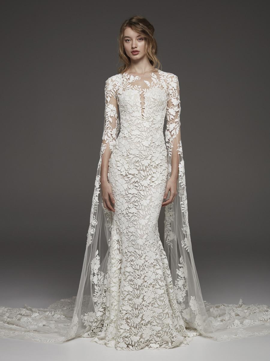 A Pronovias lace, 3/4 sleeve, mermaid wedding dress, with a cape