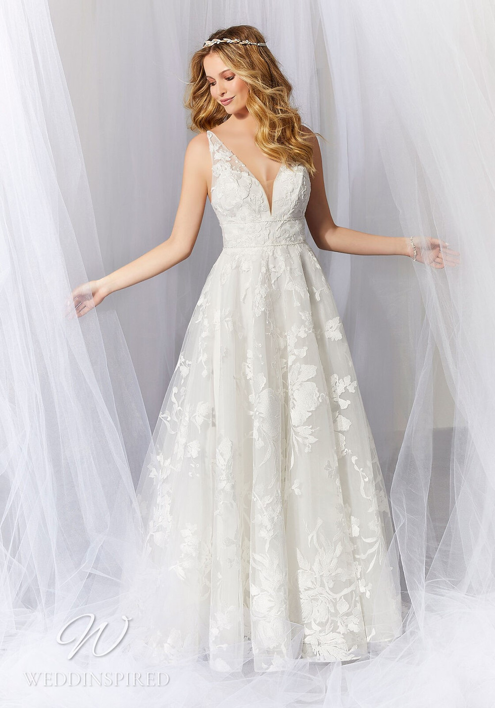 A Madeline Gardner lace and tulle A-line wedding dress with a v neck