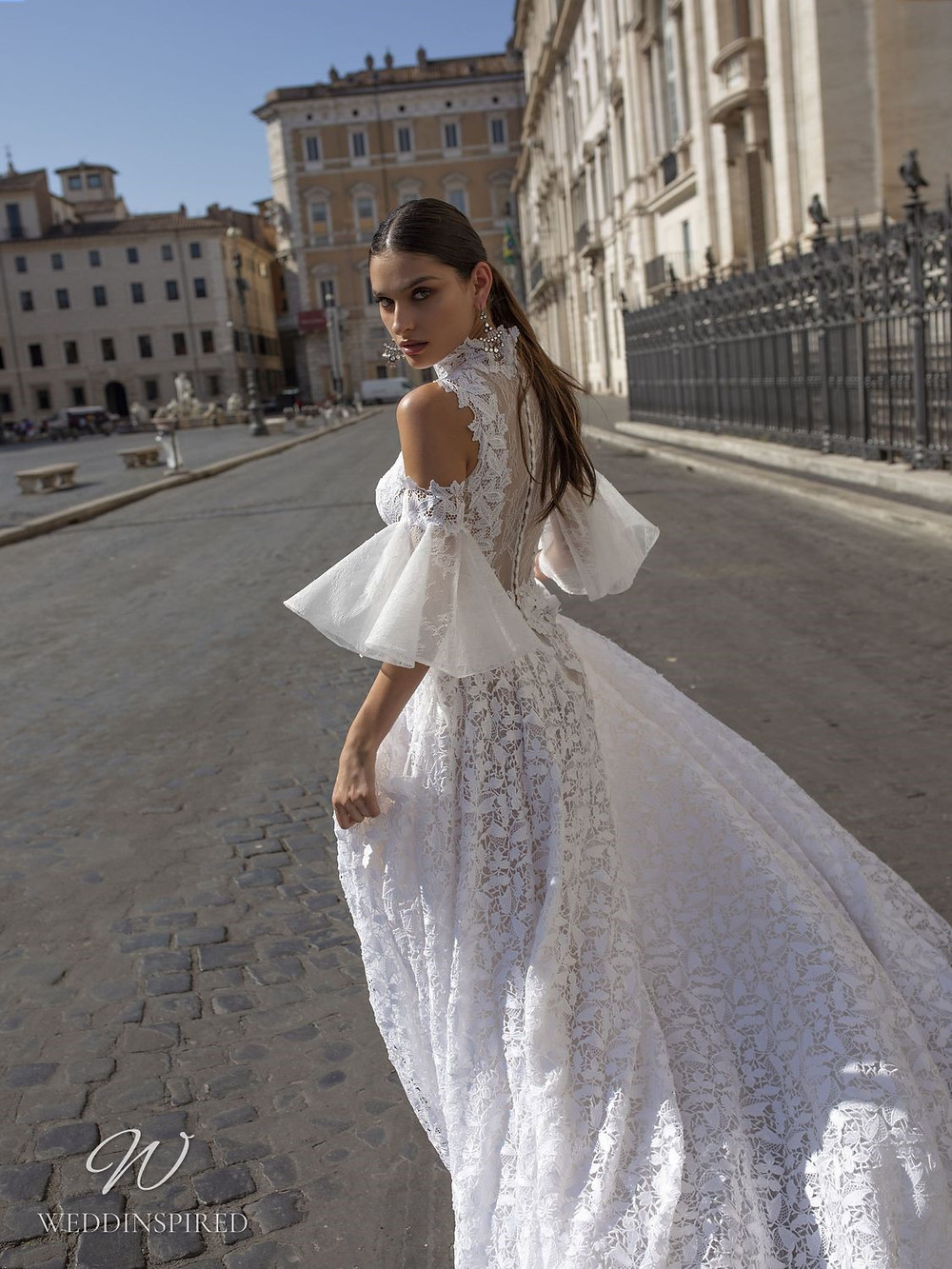 A Pinella Passaro lace A-line wedding dress with tulle bell sleeves