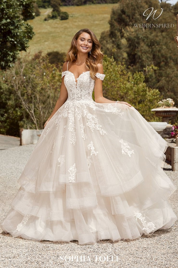 A Sophia Tolli off the shoulder ball gown wedding dress with ruffle skirt