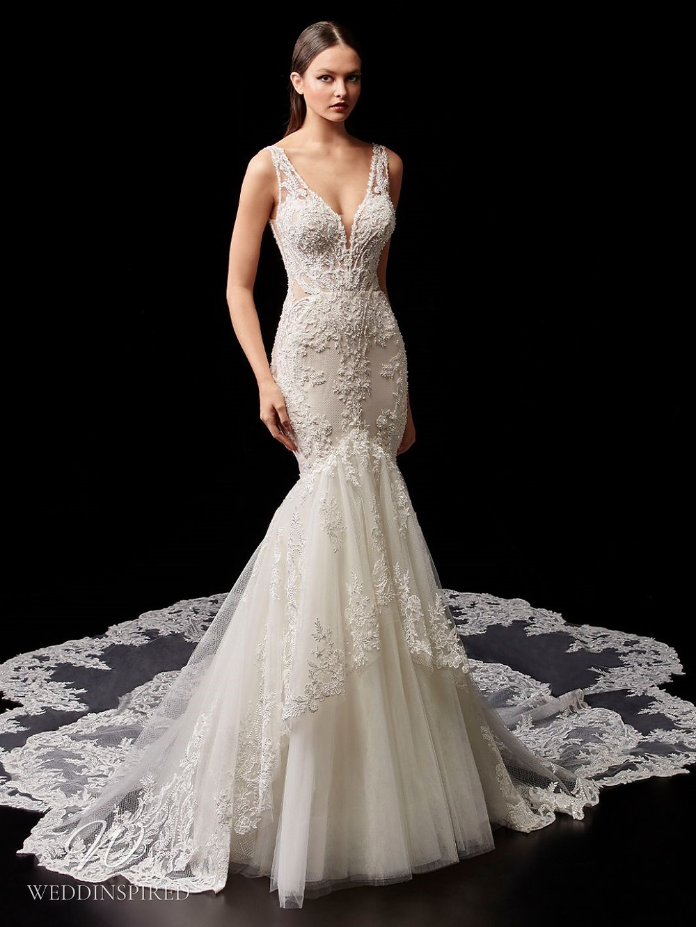 An Enzoani lace and tulle mermaid wedding dress with an illusion train