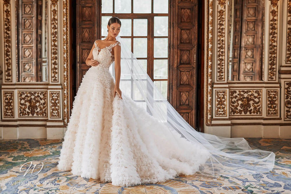 A Royal by Naviblue 2021 lace and tulle princess wedding dress with a ruffle skirt