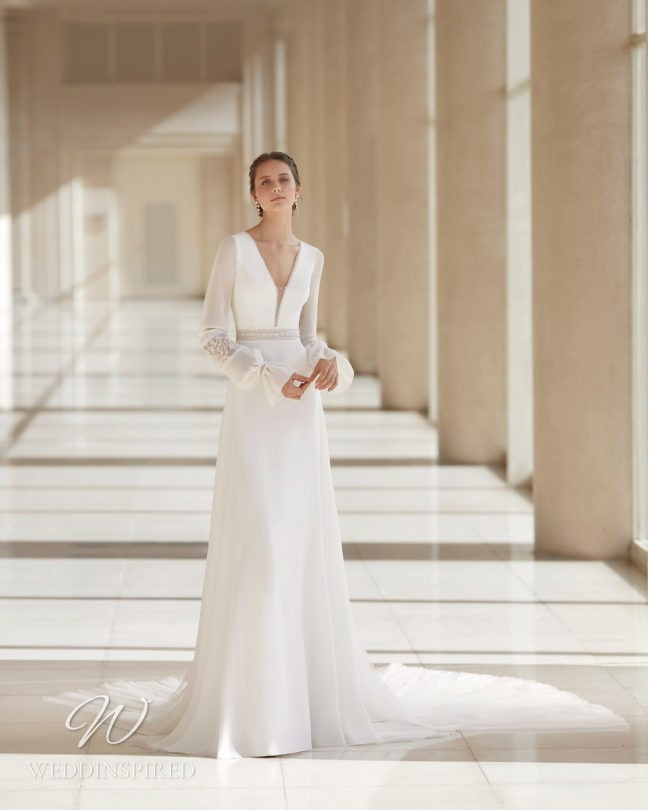 An Aire Barcelona 2021 crepe and chiffon sheath wedding dress with long sleeves