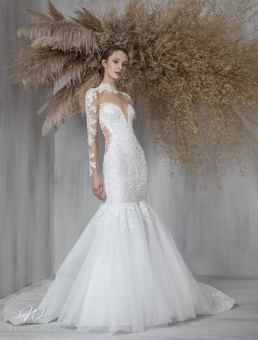 A Tony Ward 2021 lace and tulle mermaid wedding dress with long sleeves and an illusion bodice