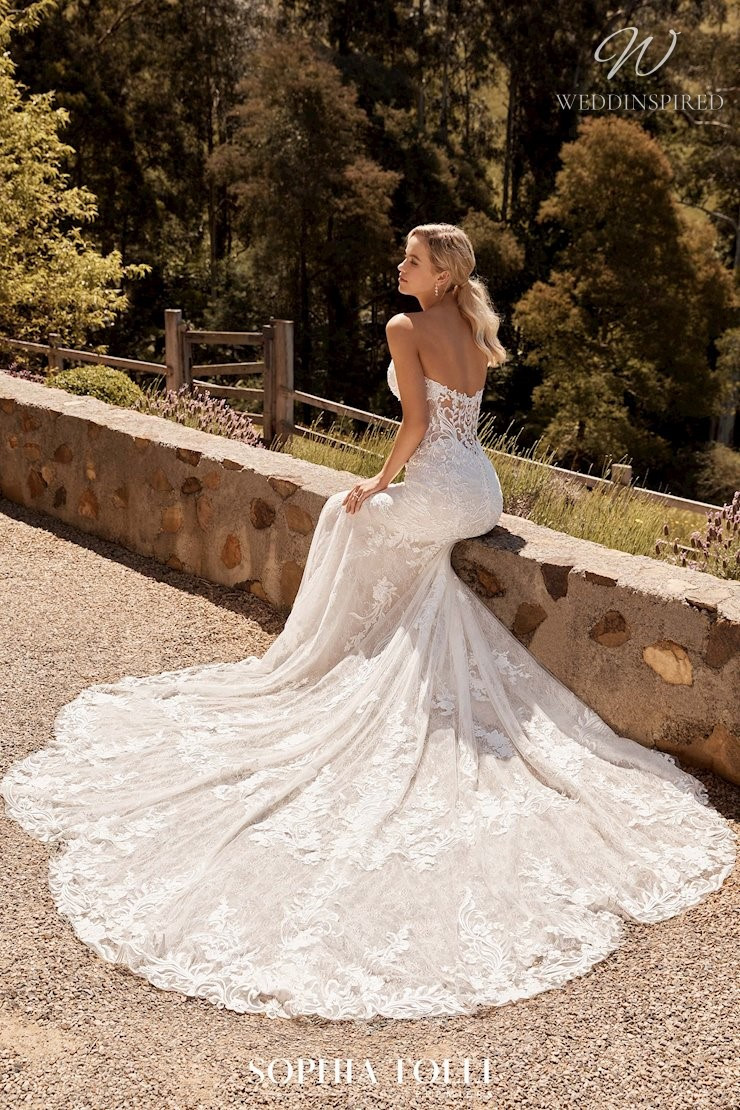 A Sophia Tolli strapless lace mermaid wedding dress