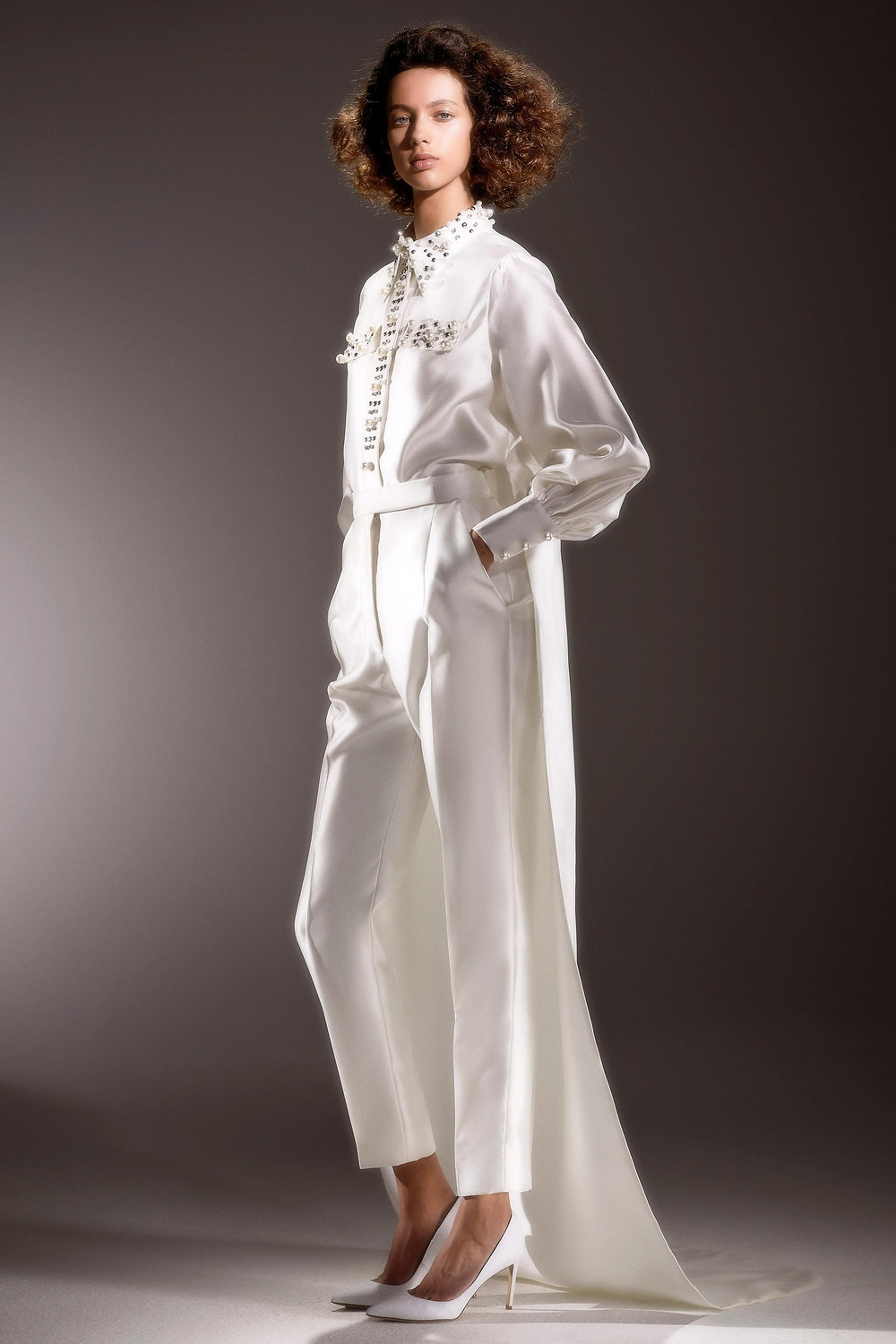 A Viktor & Rolf silk wedding jumpsuit with pearls and beading and a train