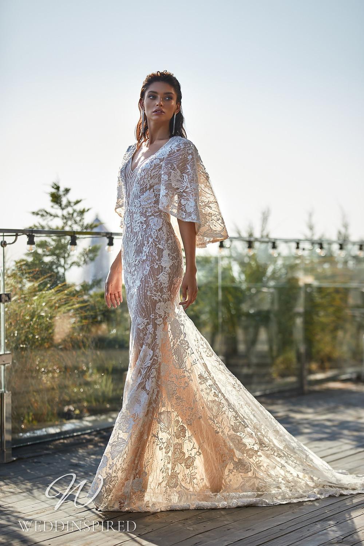 An Ida Torez 2021 flowy blush boho mermaid wedding dress