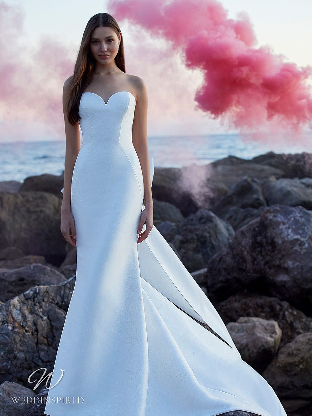A Blue by Enzoani 2021 strapless satin mermaid wedding dress with a train
