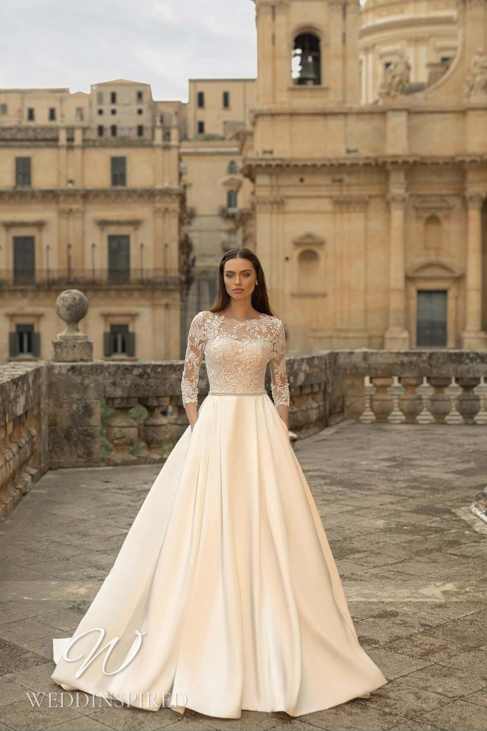 A Lussano 2021 ivory lace and satin A-line wedding dress with half sleeves