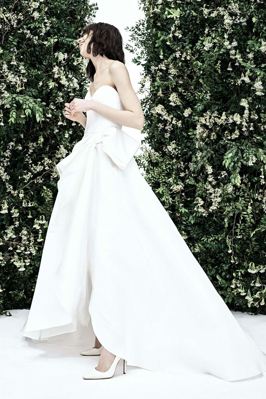A Carolina Herrera simple strapless crepe A-line wedding dress with a bow