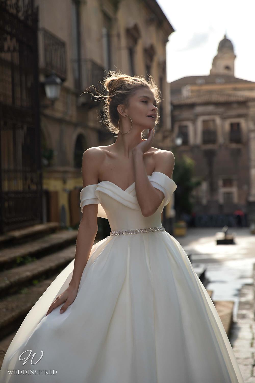A Naviblue silk off the shoulder ball gown wedding dress