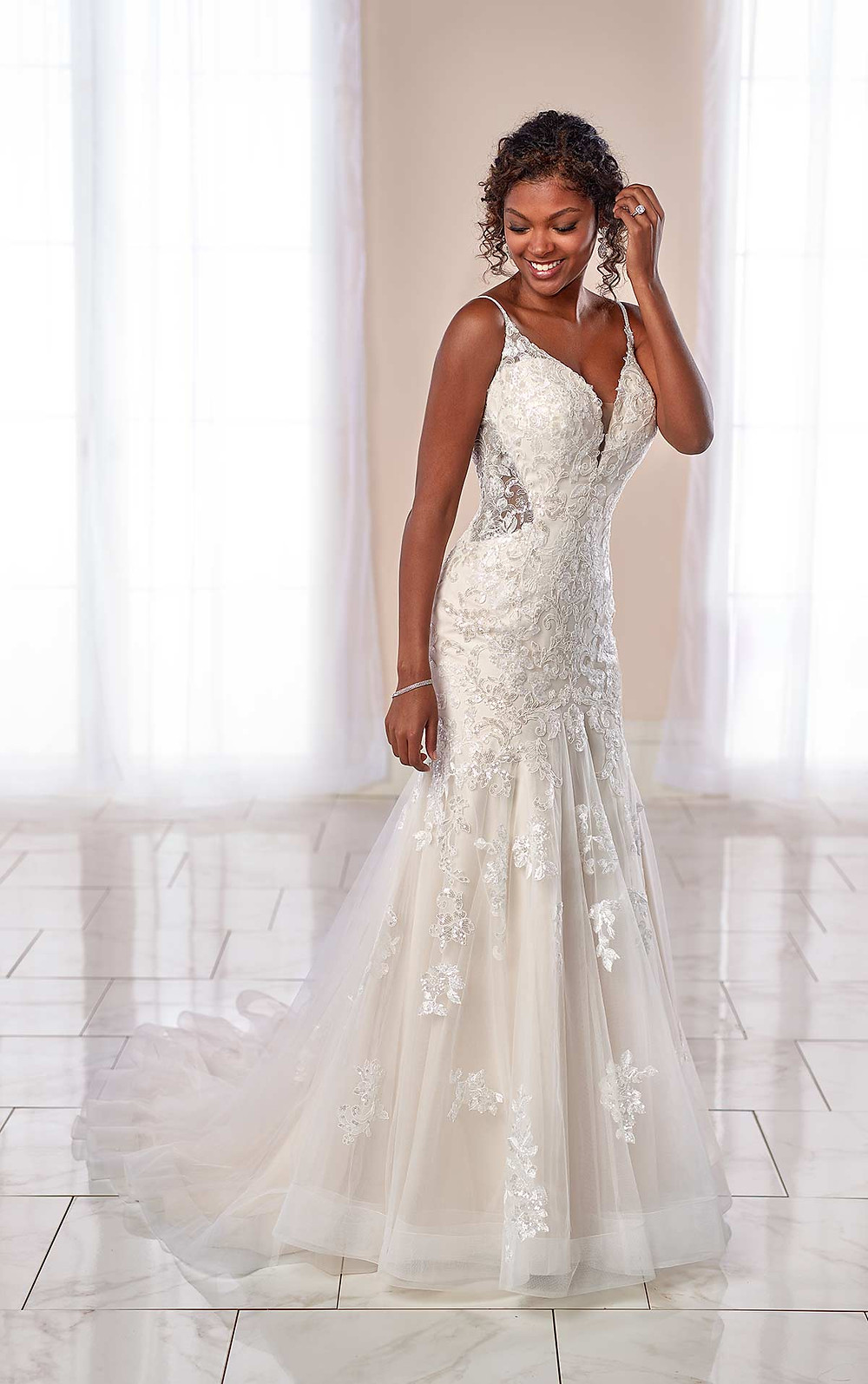 A Stella York 2020 lace and mesh mermaid fit and flare wedding dress with straps
