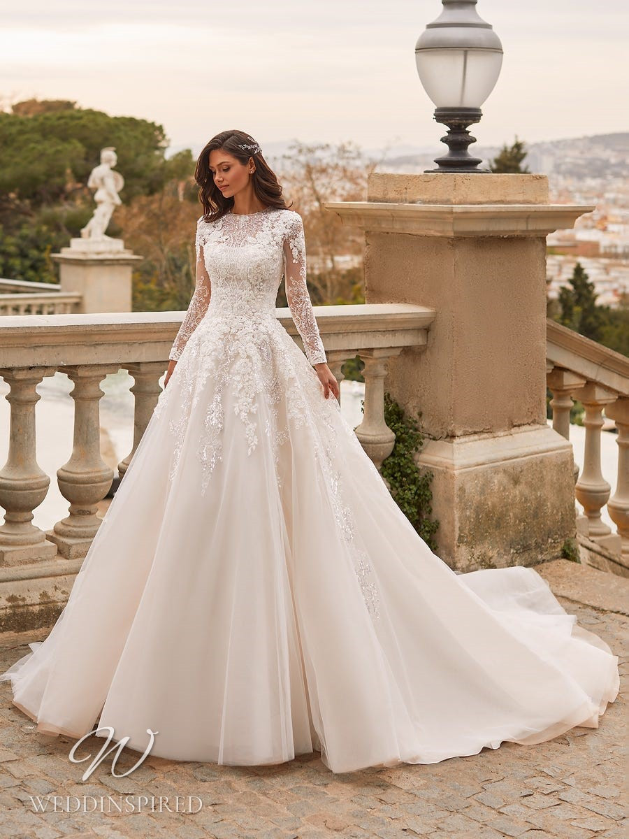 A Pronovias Privée 2021 lace and tulle blush ball gown wedding dress with long sleeves