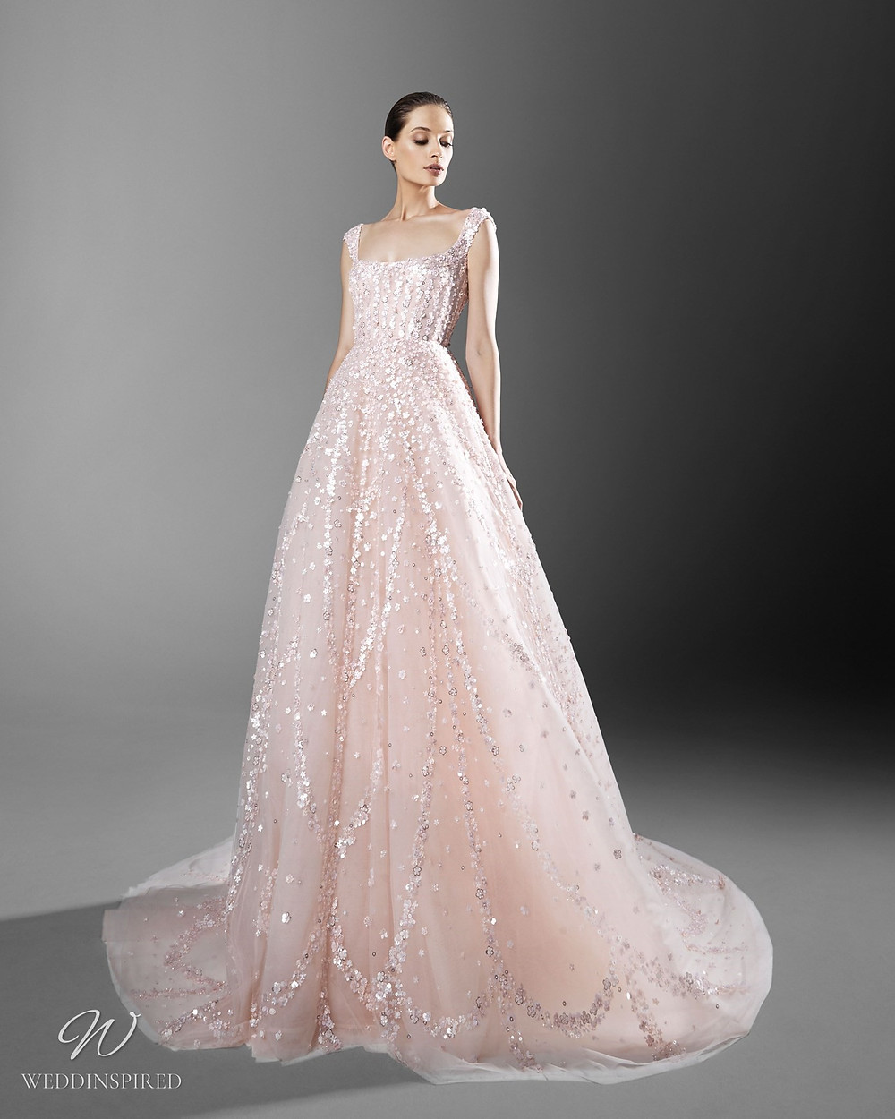 A Zuhair Murad romantic blush ball gown wedding dress with crystals and sparkles