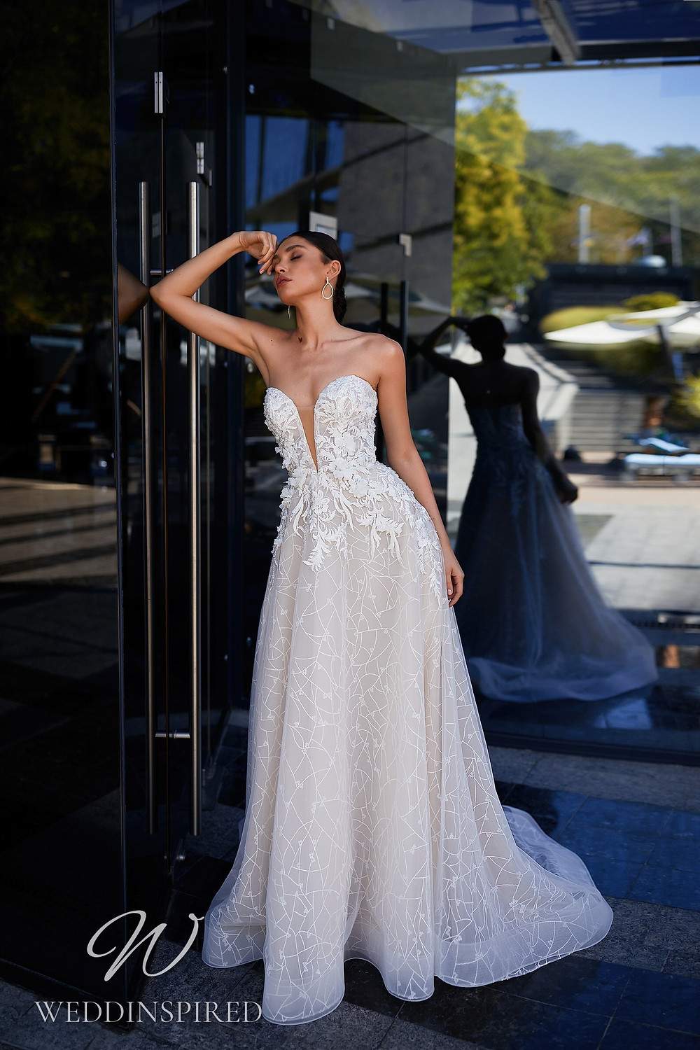 An Ida Torez 2021 strapless tulle and lace A-line wedding dress