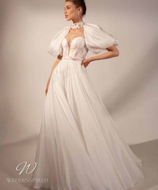 A Rara Avis 2021 strapless chiffon wedding dress with pink and gold accents and short detachable balloon sleeves