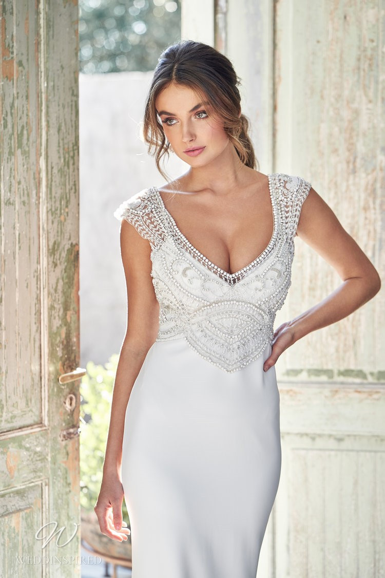An Anna Campbell 2020 fitted crepe wedding dress with beading and short sleeves